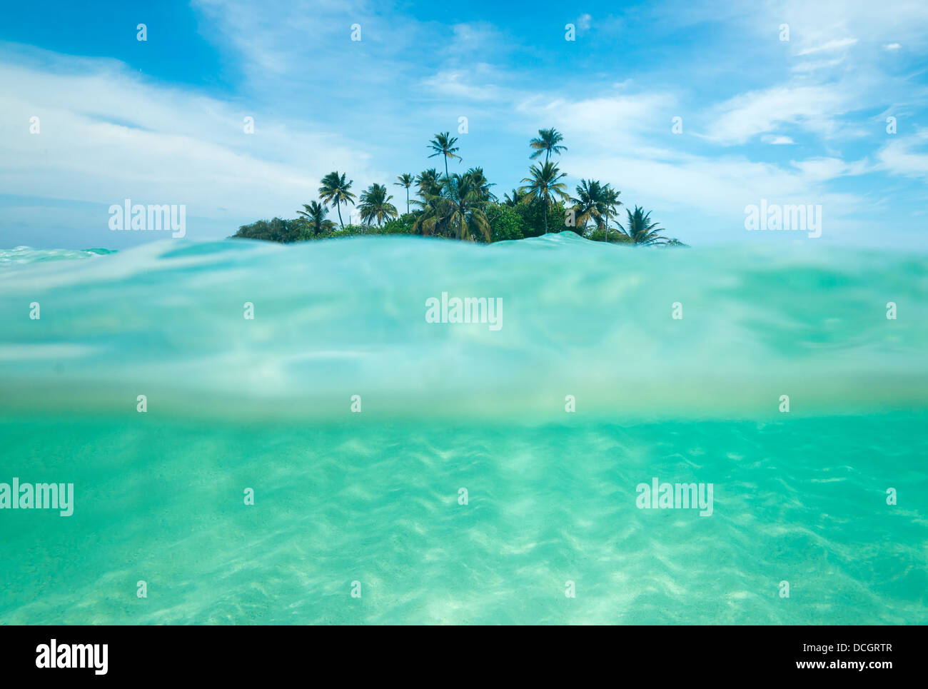 Tropical island in the ocean - Stock Image