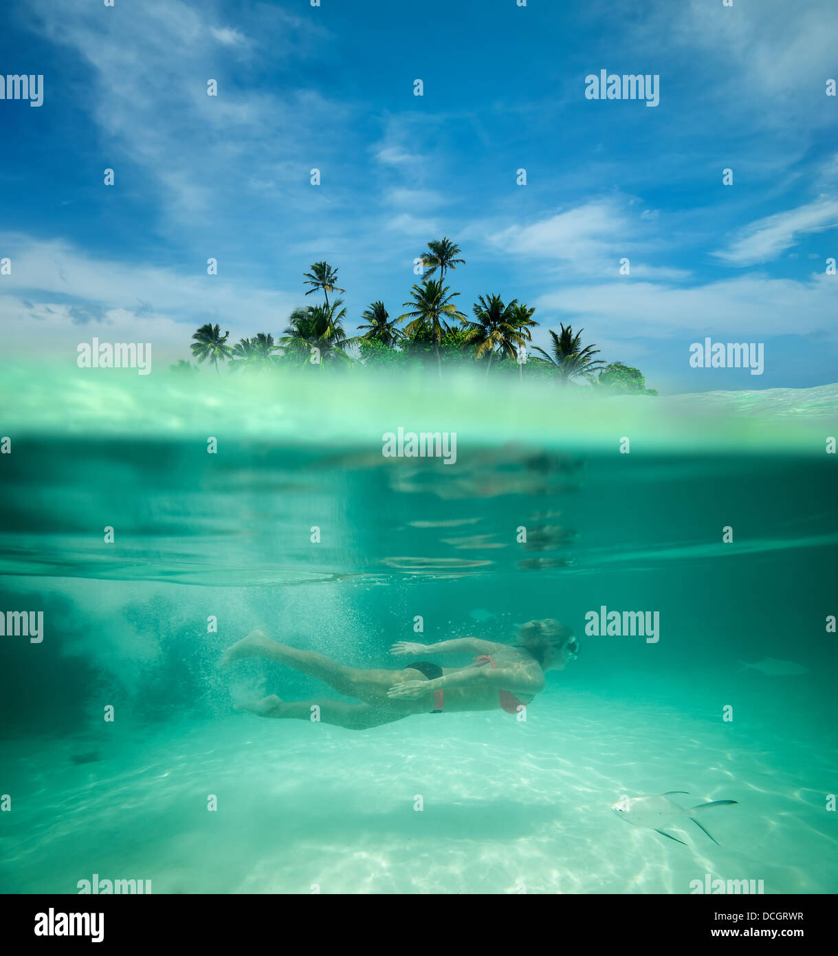 Woman snorkeling in a tropical lagoon - Stock Image