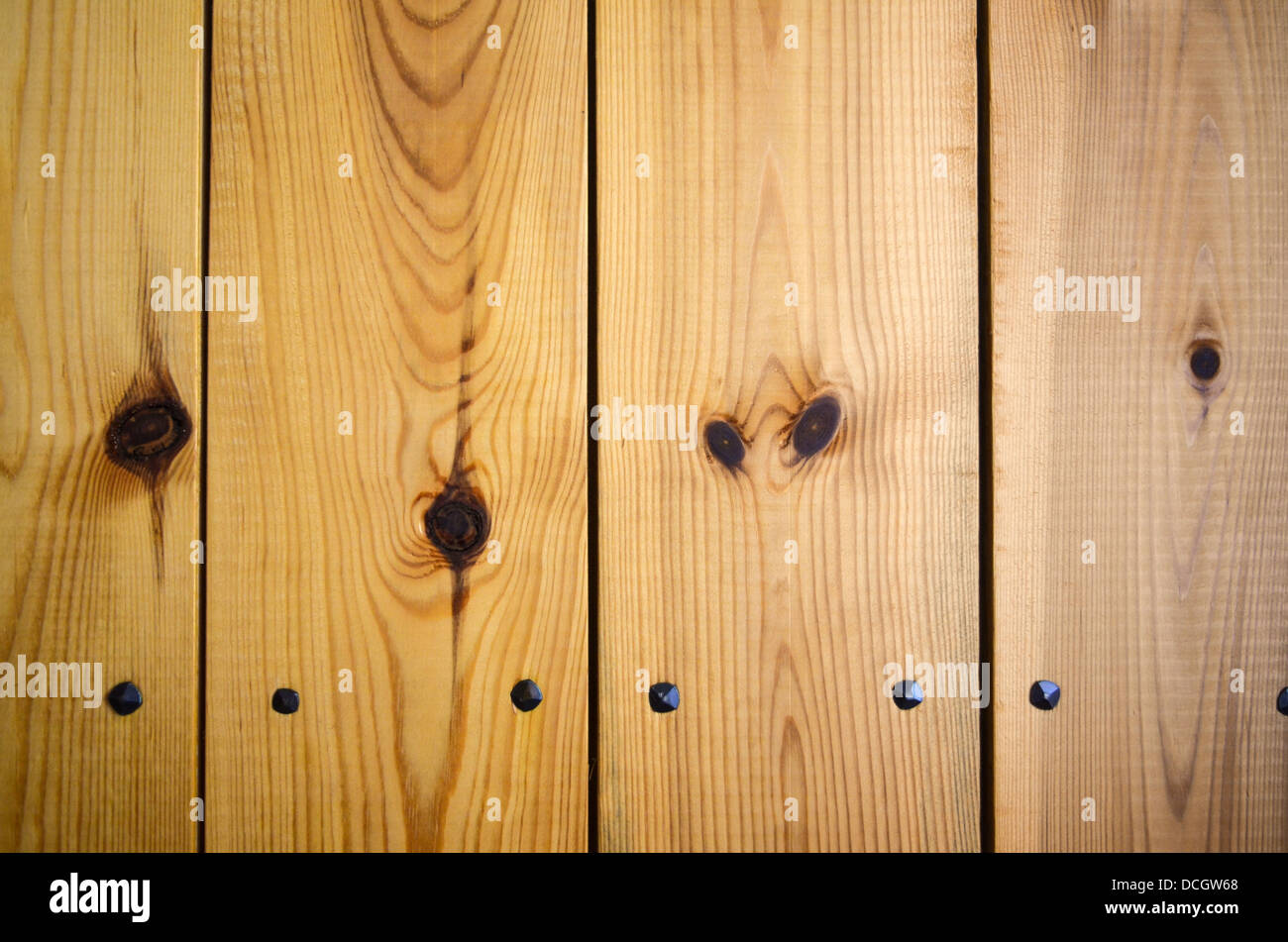 Wooden panel background with wrought iron nails Stock Photo ...