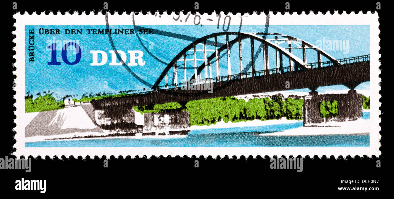 POstage stamp from East Germany depicting the Templin Lake Bridge. - Stock Image