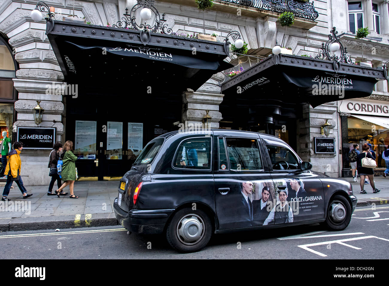 London Taxi Awaiting Fare Outside Meridian Hotel in Piccadilly - Stock Image