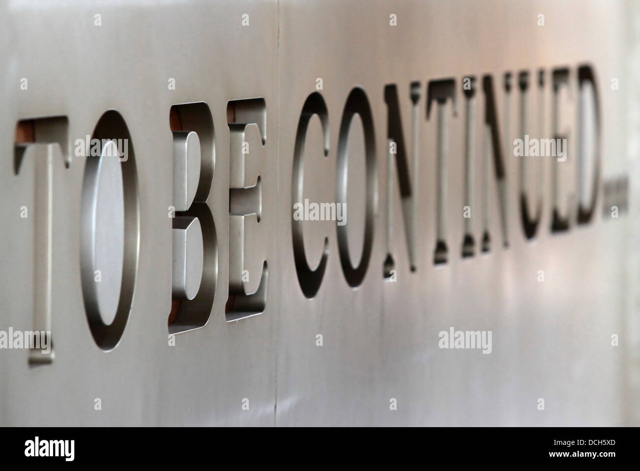 To Be Continued text debossed in marble - Stock Image