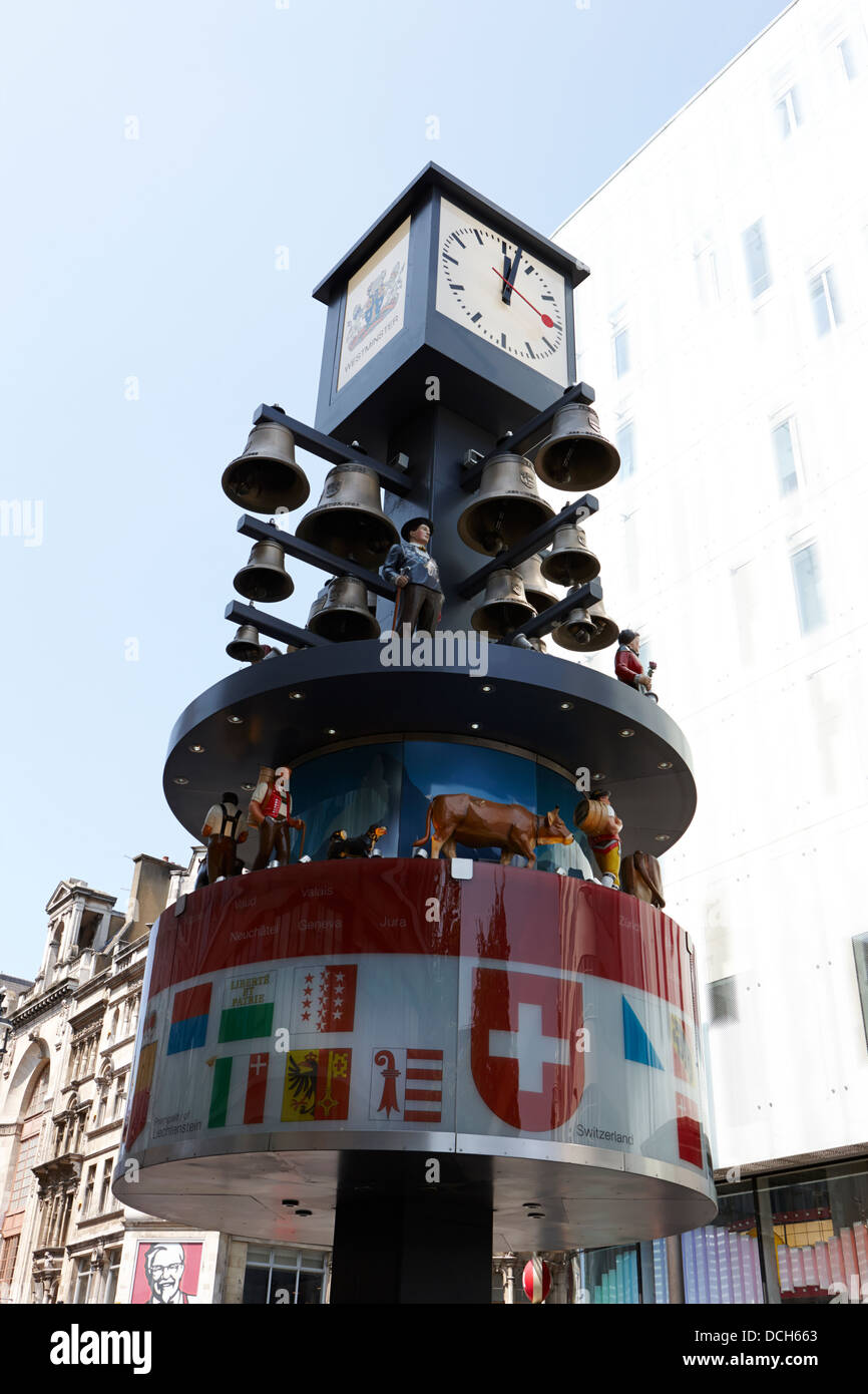 swiss clock on swiss court leicester square London England UK - Stock Image