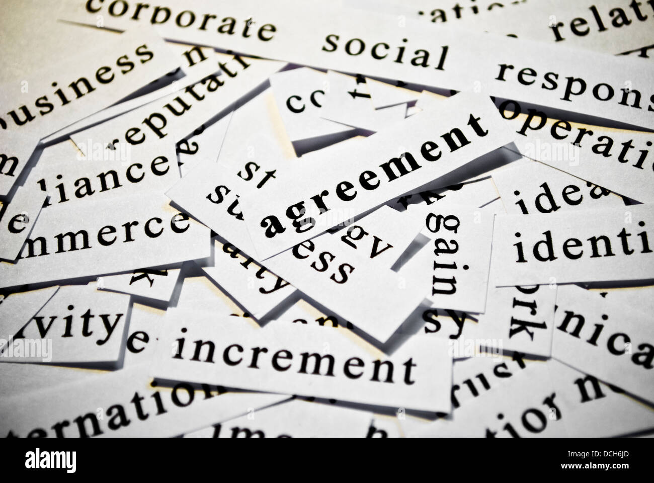 Agreement. Concept of cut-out words related with business activity ...