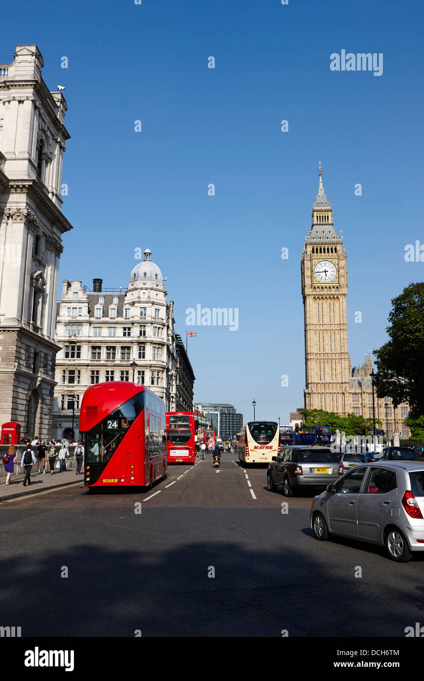 street scene with new london bus houses of parliament London England UK - Stock Image