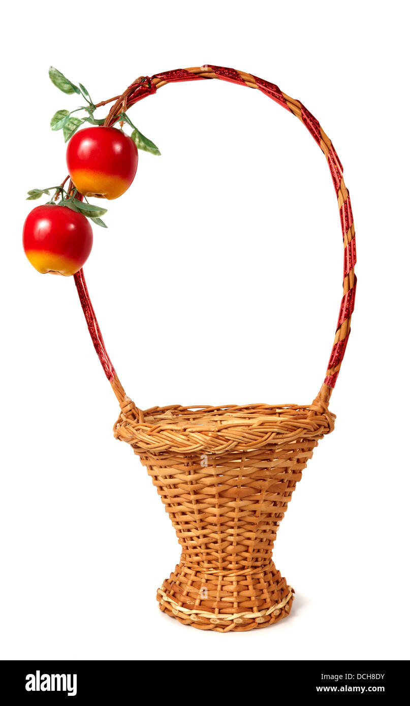 Wicker basket decorated with two artificial apples - Stock Image