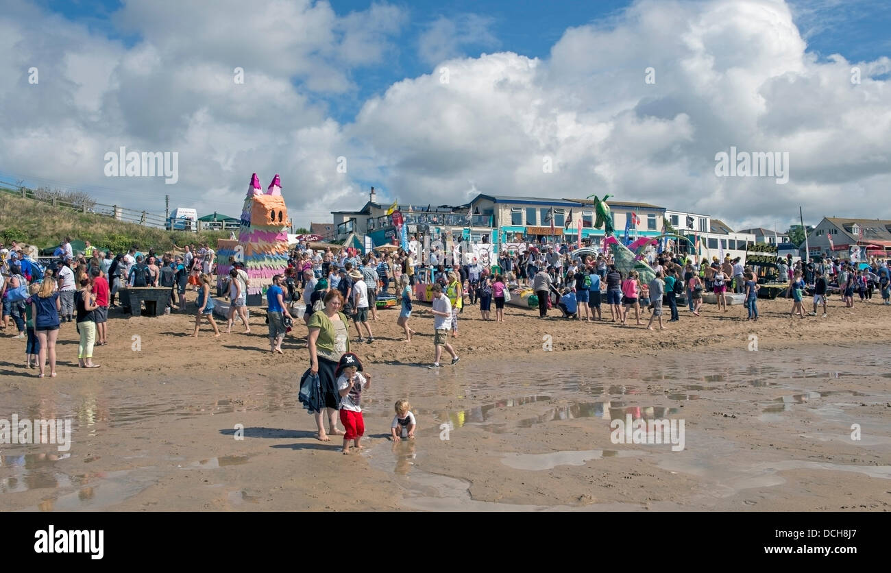 Cornwall, UK, 18th August 2013. Crowds check over the raft entries before racing begins.  This is the sixth year - Stock Image