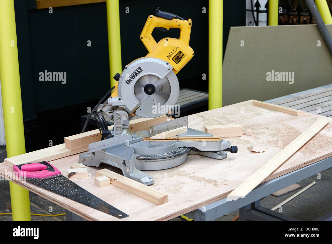 circular mitre saw on carpenters table on building site London England UK - Stock Image
