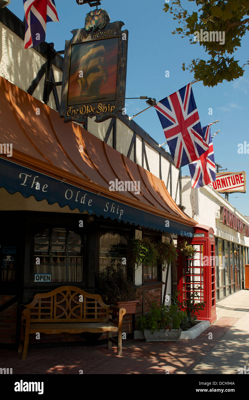 A British telephone box outside The Olde Ship, a British run and British owned pub in Fullerton, Southern California - Stock Image