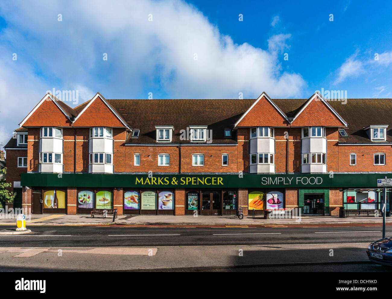 Marks and & Spencer (M&S) store / shop, with no traffic outside, on Banstead Village High Street, on a quiet - Stock Image