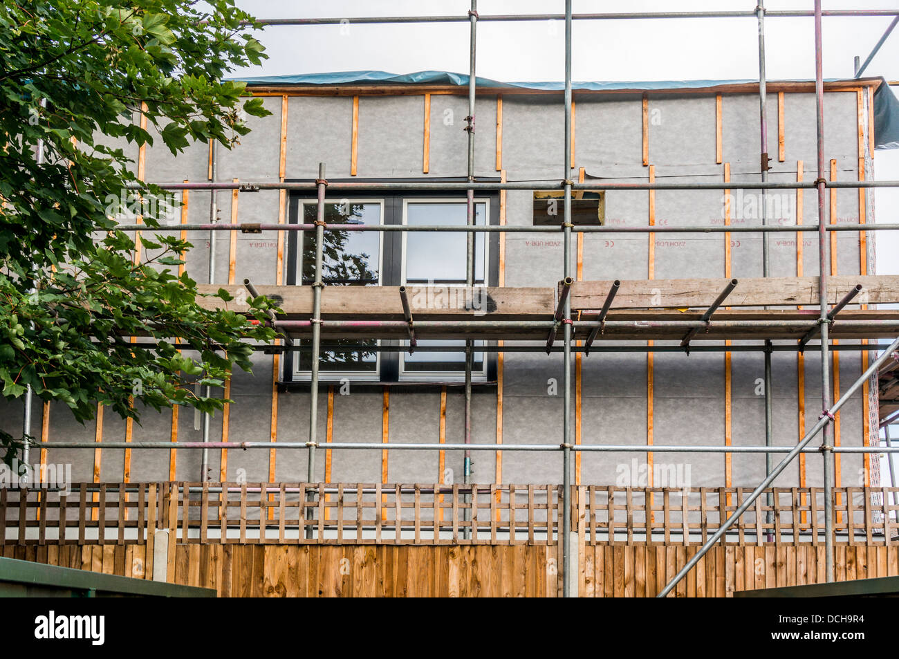 Scaffolding around a new building - a new construction to extend an existing school in Banstead, Surrey, England, - Stock Image