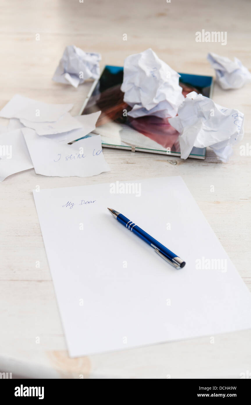 Love letter crumpled paper sheets pen picture - Stock Image