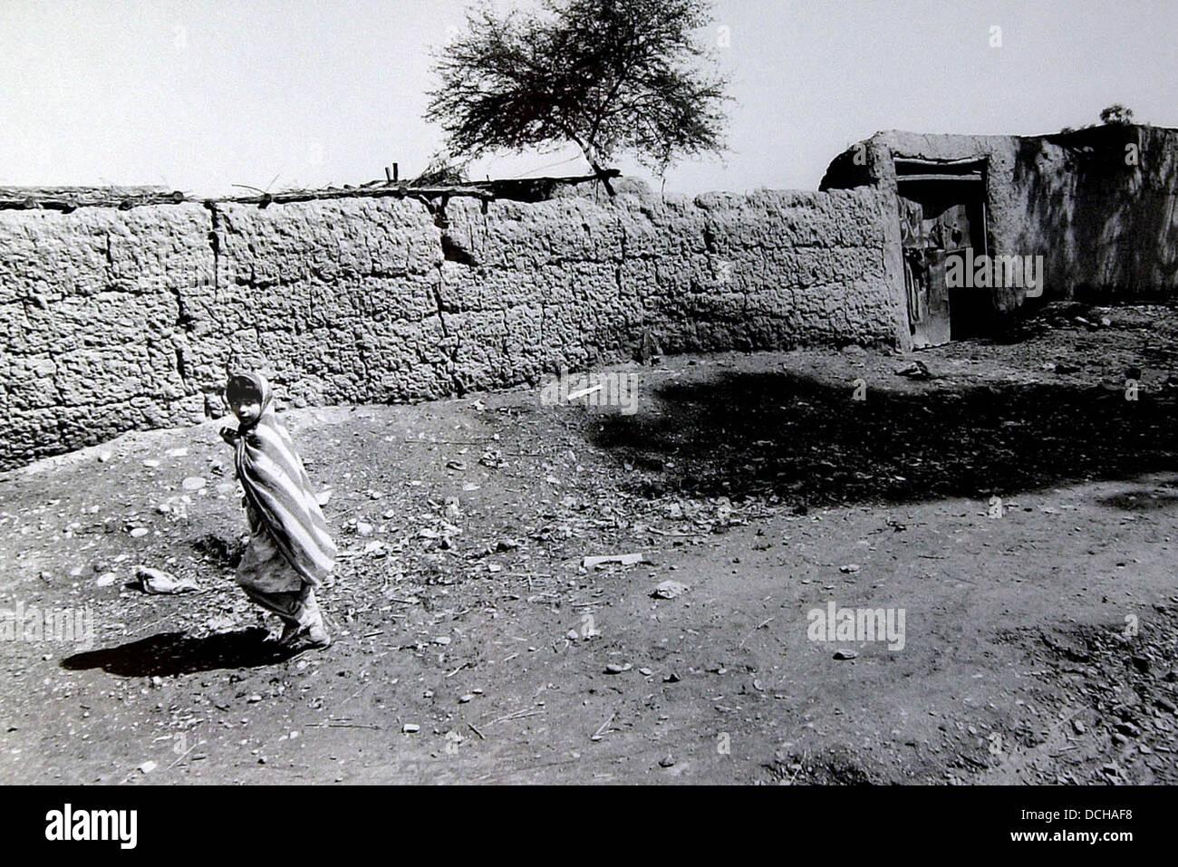 A young girl walks through a refugee camp near peshawar pakistan stock image