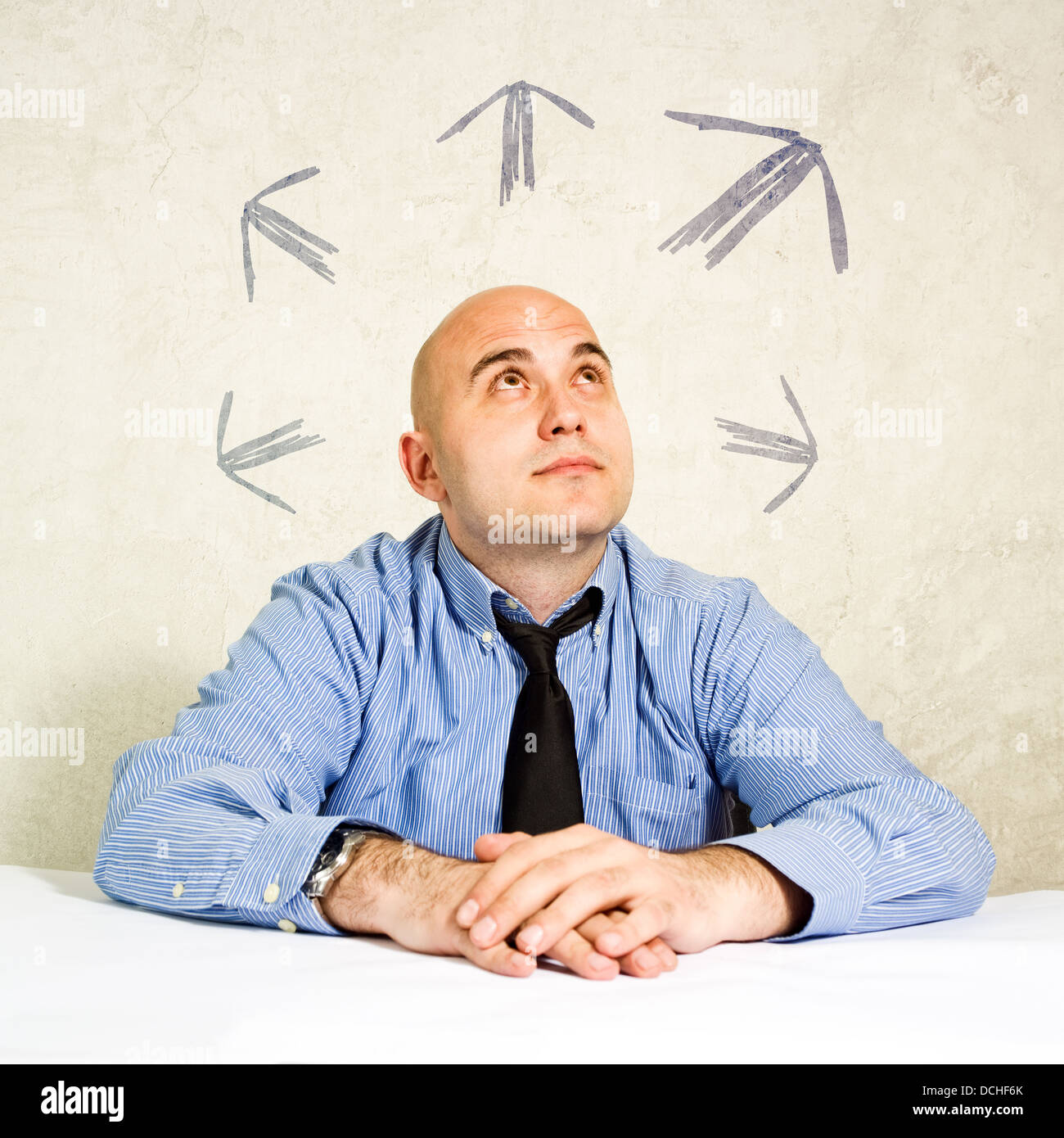 Business man looking upward. Business choice or business options concept. - Stock Image