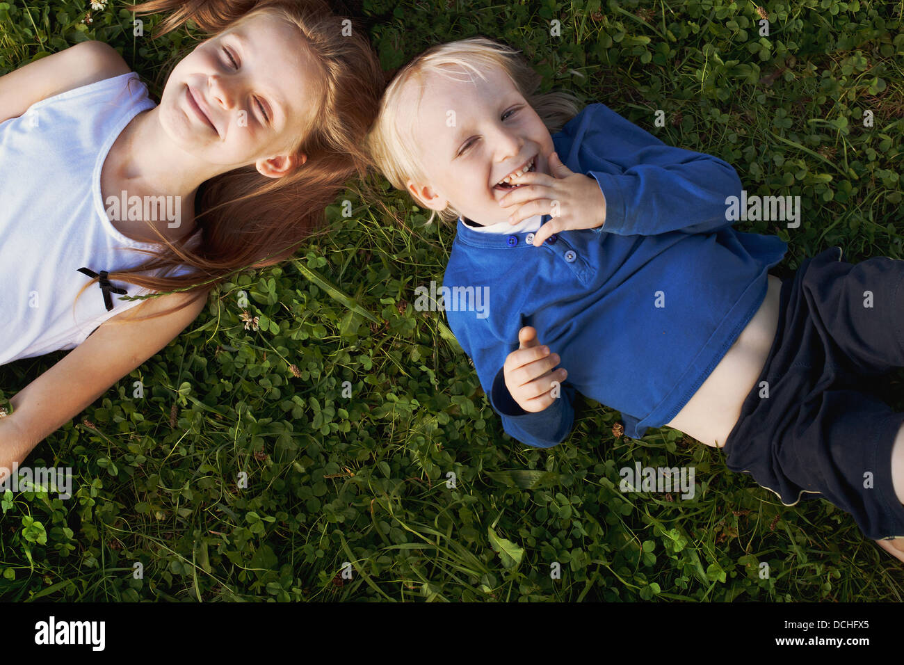 happy cute children on the grass - Stock Image