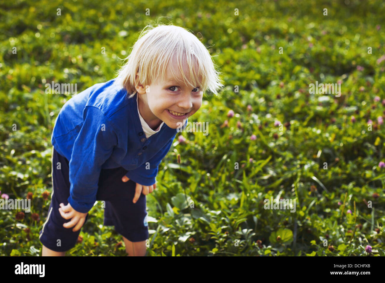cute crafty little boy outdoors, portrait of smiling child - Stock Image