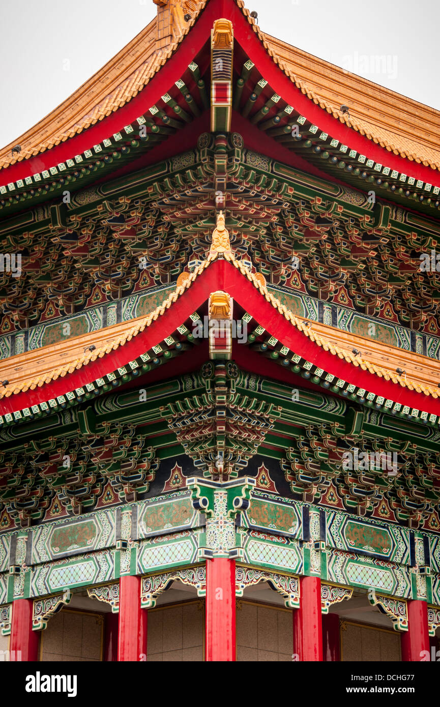 A detail showing the ornate roof at the corner of the National Concert Hall in Taipei, Taiwan. - Stock Image