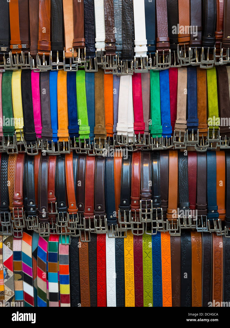 Leather belts for sale in street market in Florence, Italy - Stock Image