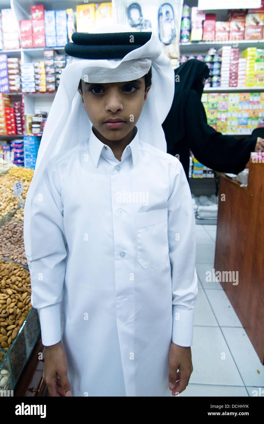 A young Qatari boy waring a traditional Jalaba and keffiyeh/kufiya. Stock Photo