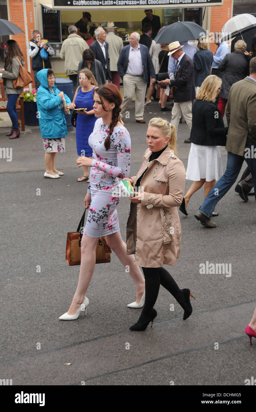 Two people enjoying a day at the races - Stock Image
