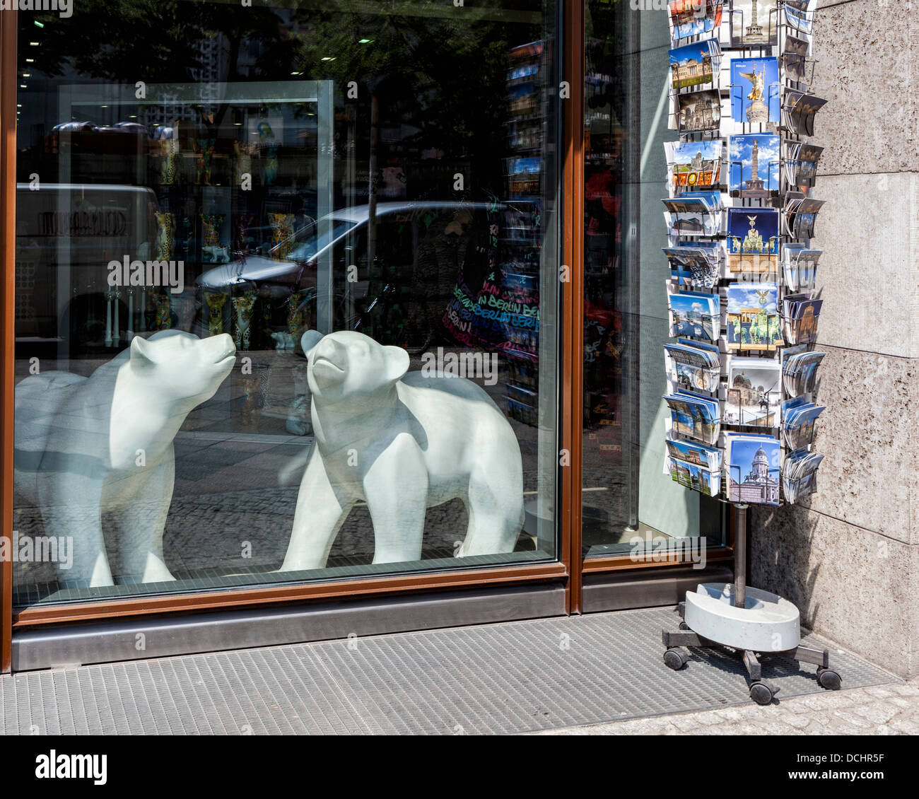 Two white Berlin bears and a rack of postcards in front of a curio shop in Unter den Linden, Berlin - Stock Image