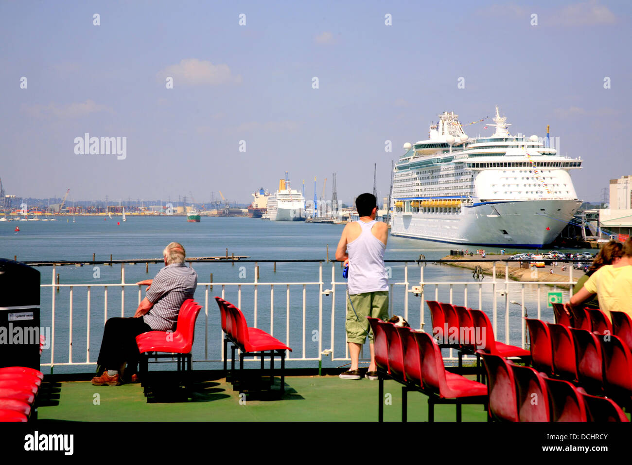 Cruise liners preparing for cruise in Southampton Docks, taken from the Isle of Wight ferry. - Stock Image
