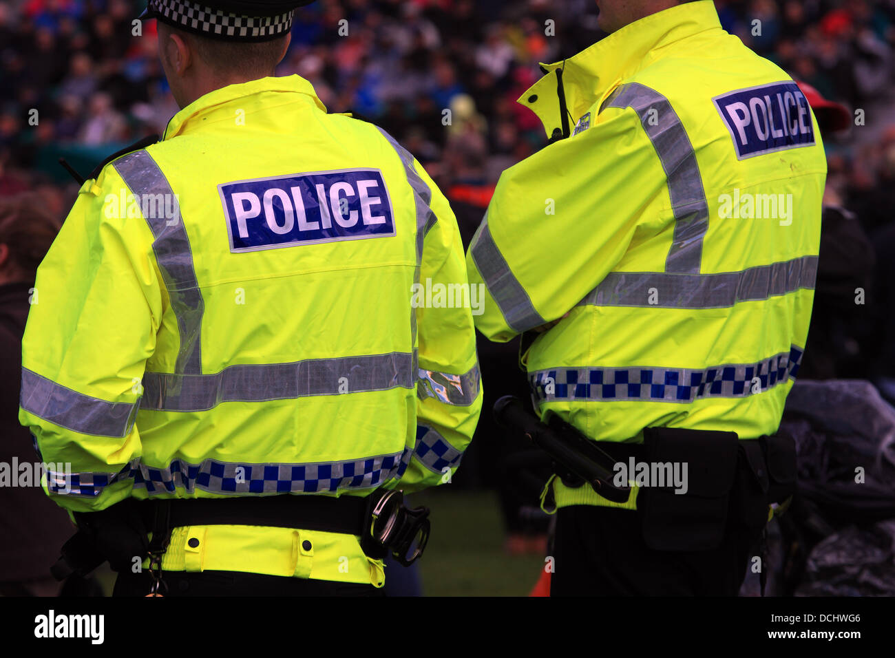 UK police officers patrolling at a large crowd venue - Stock Image