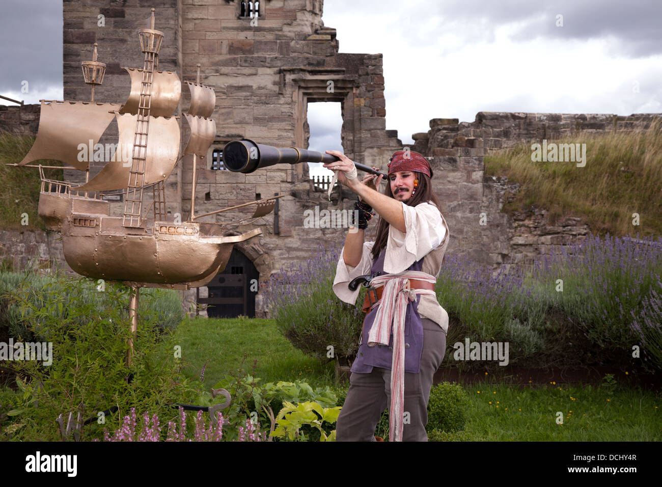 Pirate with telescope and Galleon garden ornament at Tutbury castle, Staffordshire, UK - Stock Image