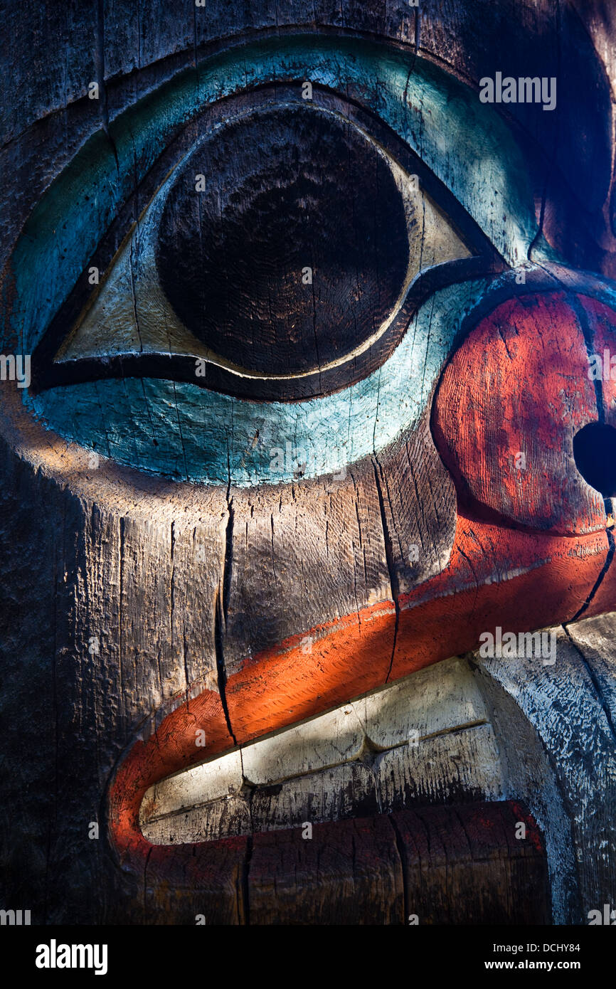 Partial detail of a totem in the shade of trees, Victoria, Canada - Stock Image