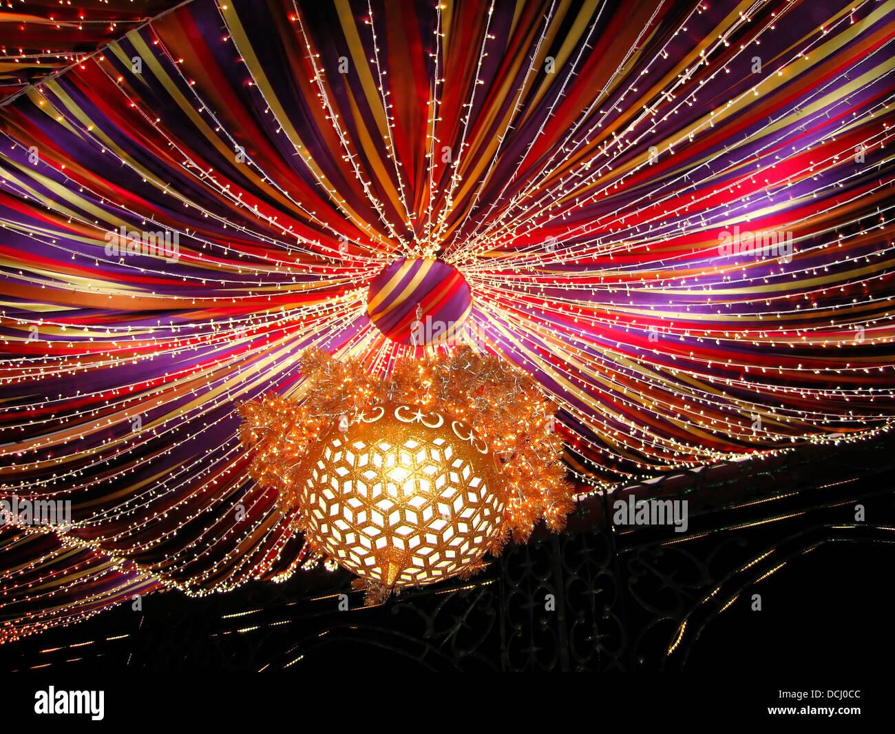 Christmas Decoration X-mas Ribbons Celebration Glowing Lights,December 25 - Stock Image