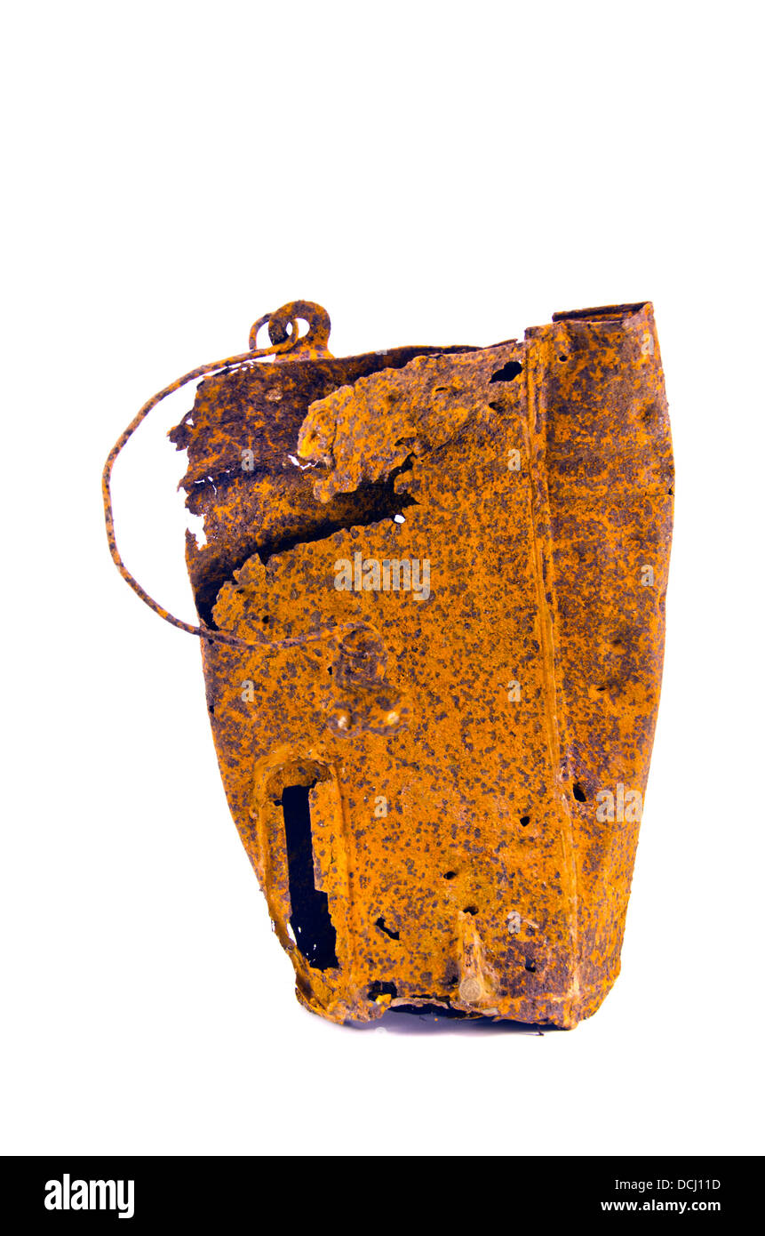 old rusty metal bucket for milk isolated on white background. Scrap iron - Stock Image