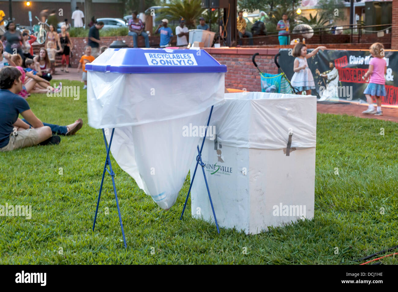 Collapsible portable recyclable trash bins and box at outside public event. - Stock Image