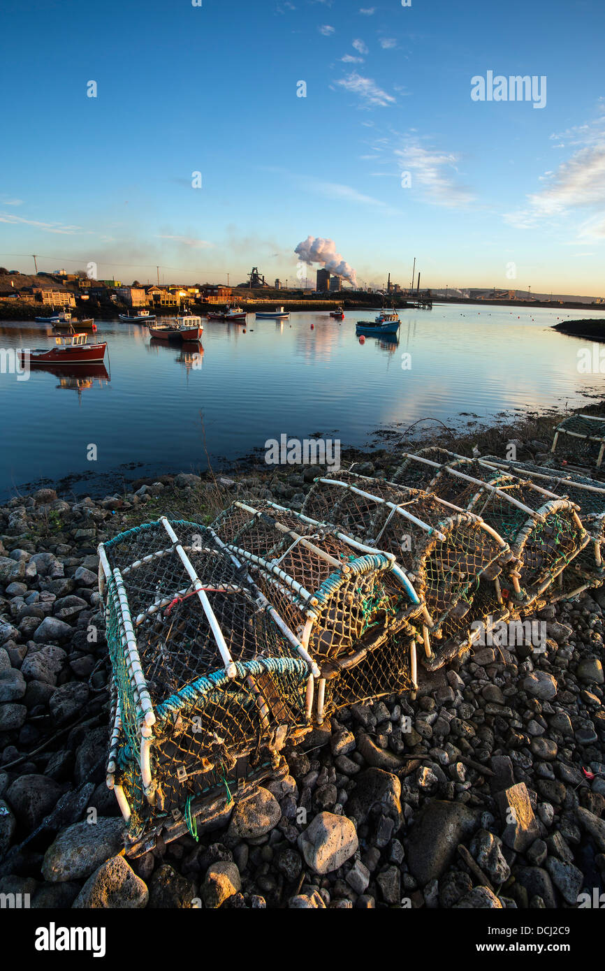 Crab pots and Steel Works, Paddys Hole, Redcar, Cleveland - Stock Image