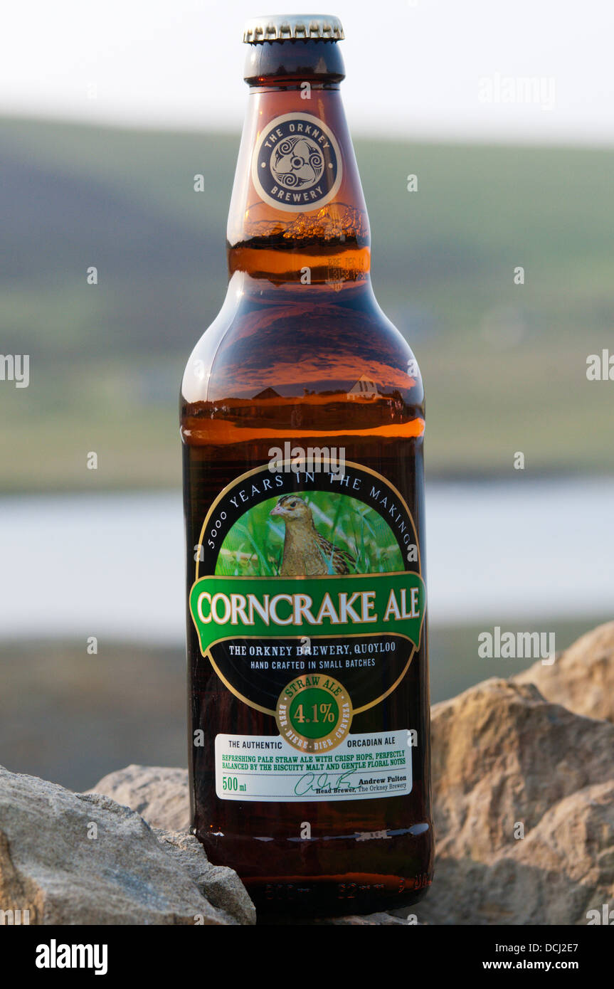 A bottle of the Orkney Brewery's Corncrake Ale, in front of the Bay of First, Mainland, Orkney. Stock Photo