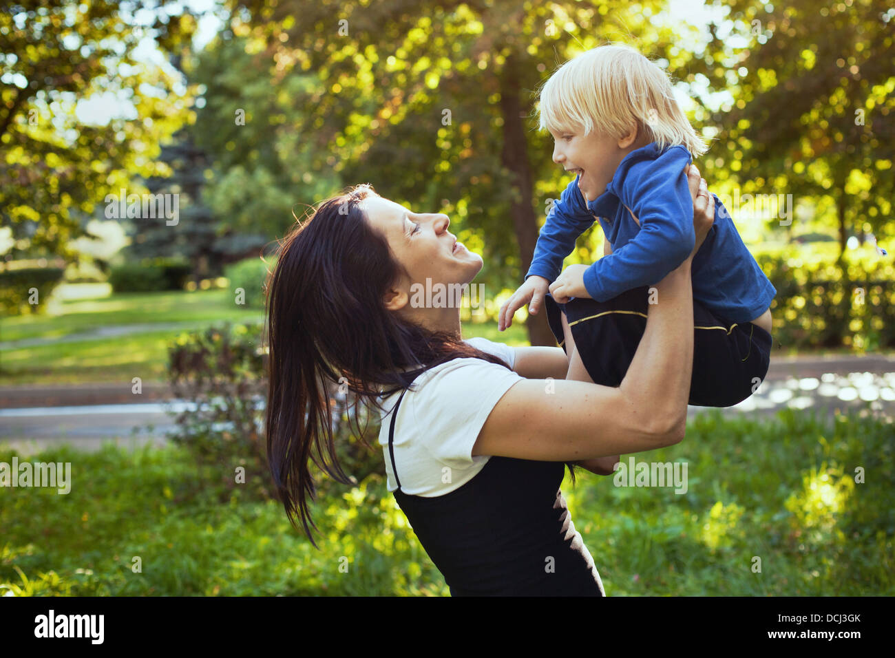 happy family, mother playing with son - Stock Image
