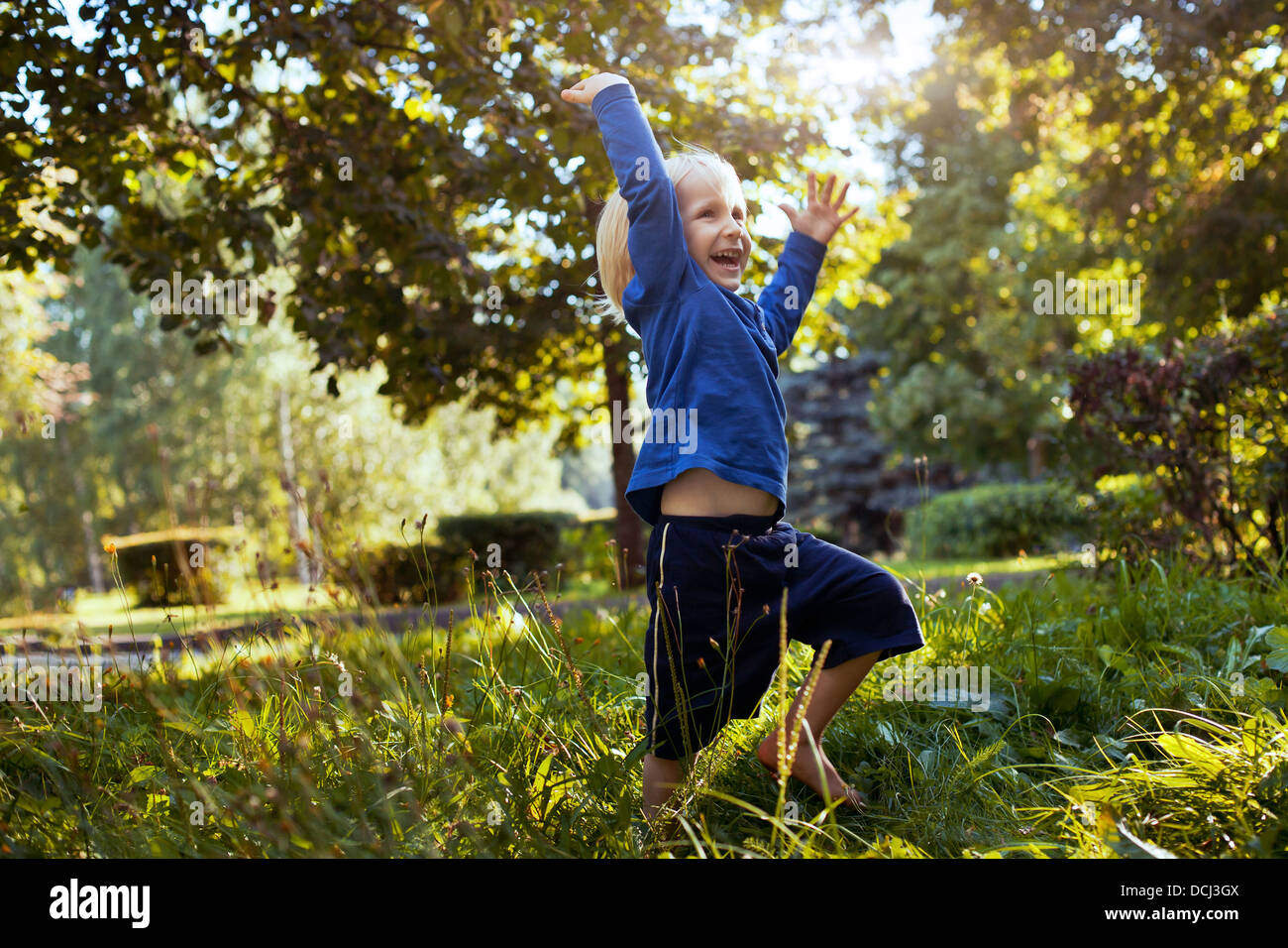 happy little boy playing in the park outdoors - Stock Image