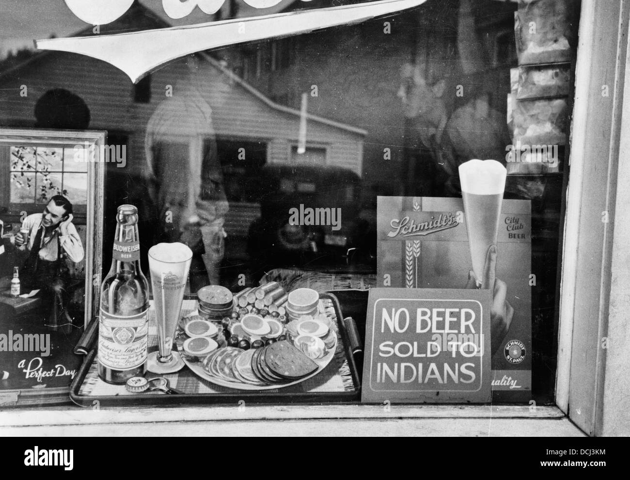 No Beer Sold to Indians - Sign in beer parlor window, Sisseton, South Dakota, circa 1939 Stock Photo