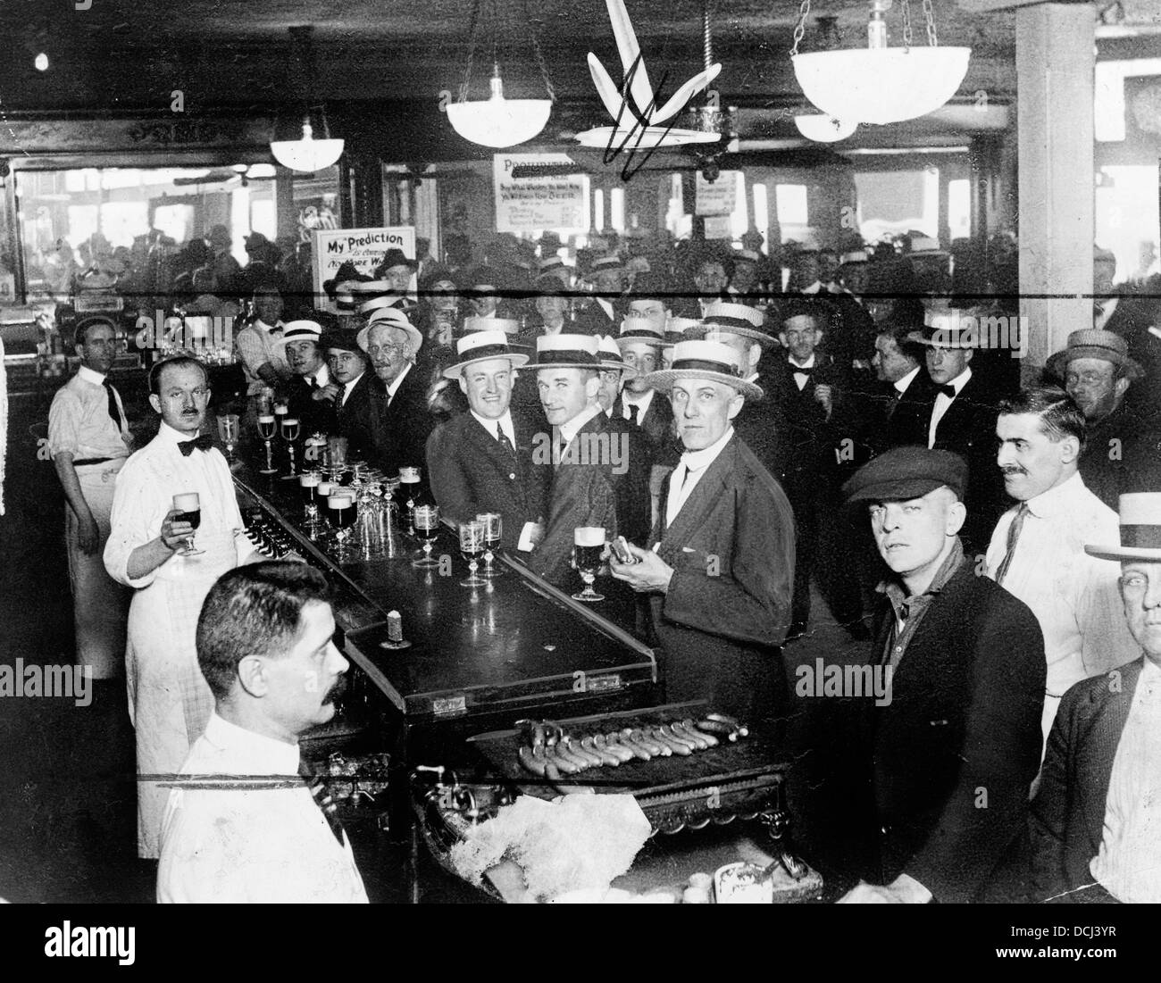Interior of a crowded bar moments before midnight, June 30, 1919, when prohibition went into effect New York City - Stock Image