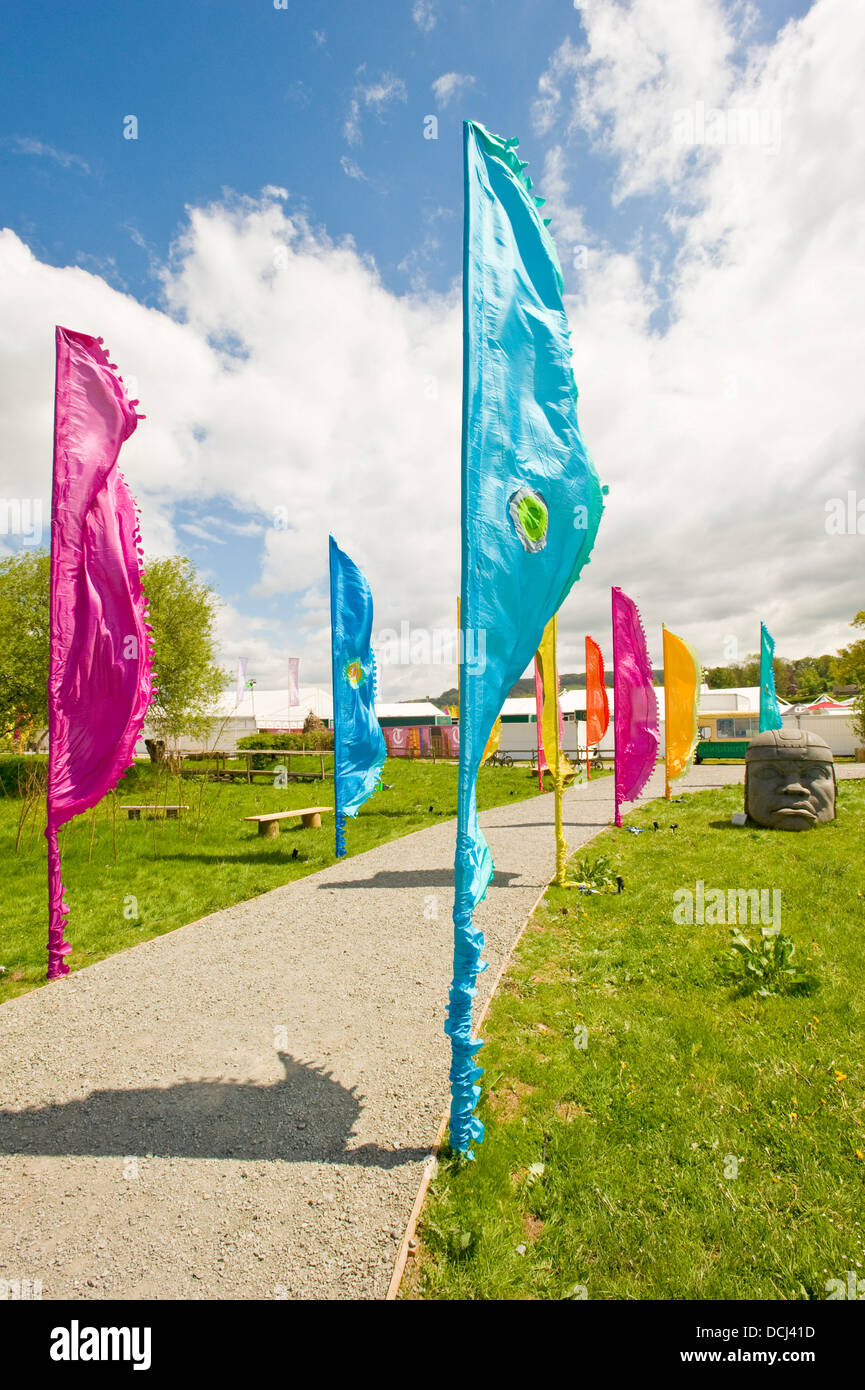 The main public entrance to the Hay festival with coloured banners in the foreground. - Stock Image