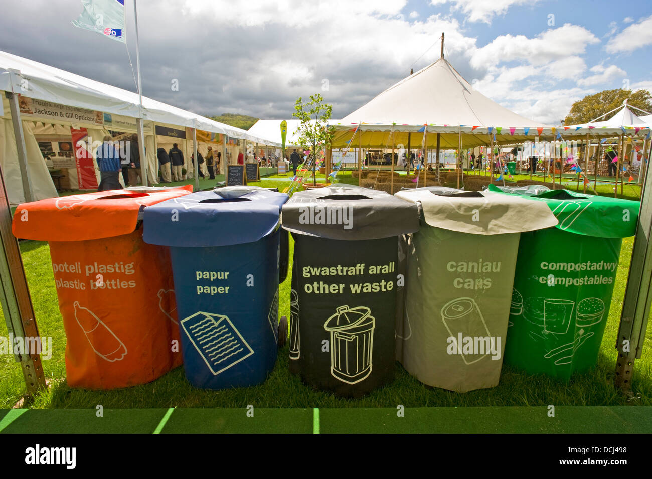 Recycling bins at the Hay festival with English and Welsh names. - Stock Image