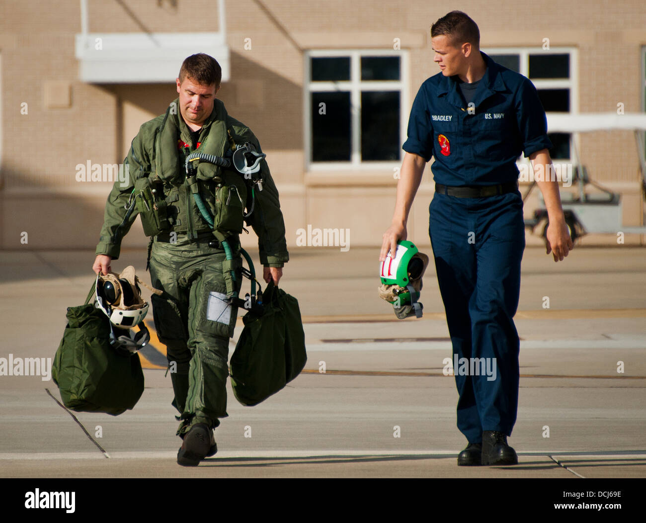 Lt. Cdr. Chris Tabert walks to the flightline to pilot the first F-35C Lightning II flight at Eglin Air Force Base - Stock Image