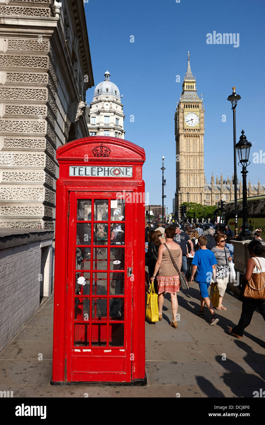 red telephone box near the houses of parliament London England UK - Stock Image