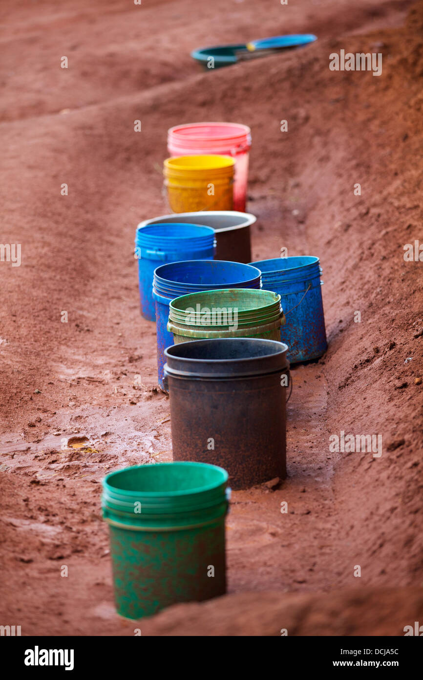 Buckets to collect rainwater, Tanzania - Stock Image