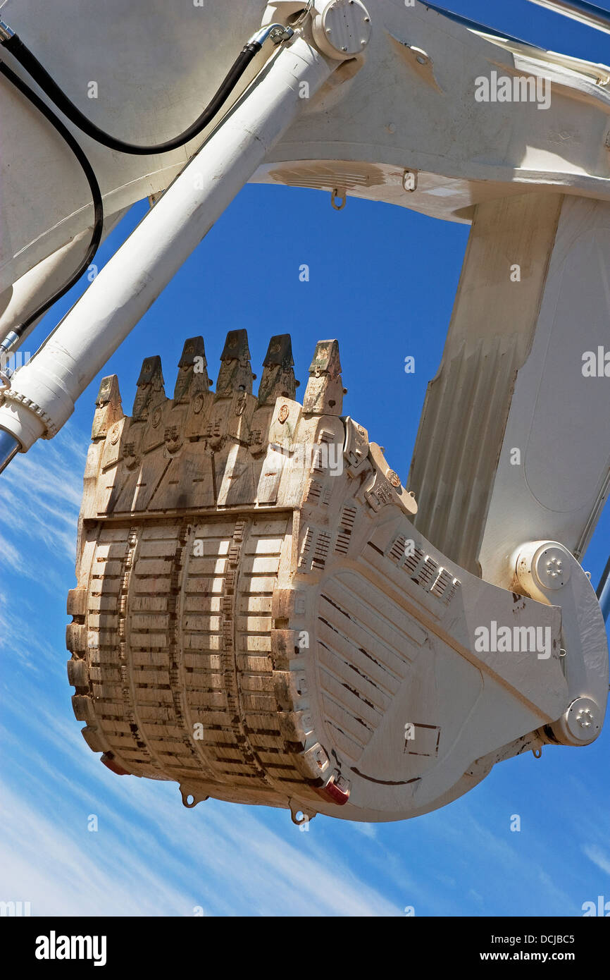 Open pit gold mining in Mauritania. Close up of giant excavator bucket about to mine ore. West Africa - Stock Image