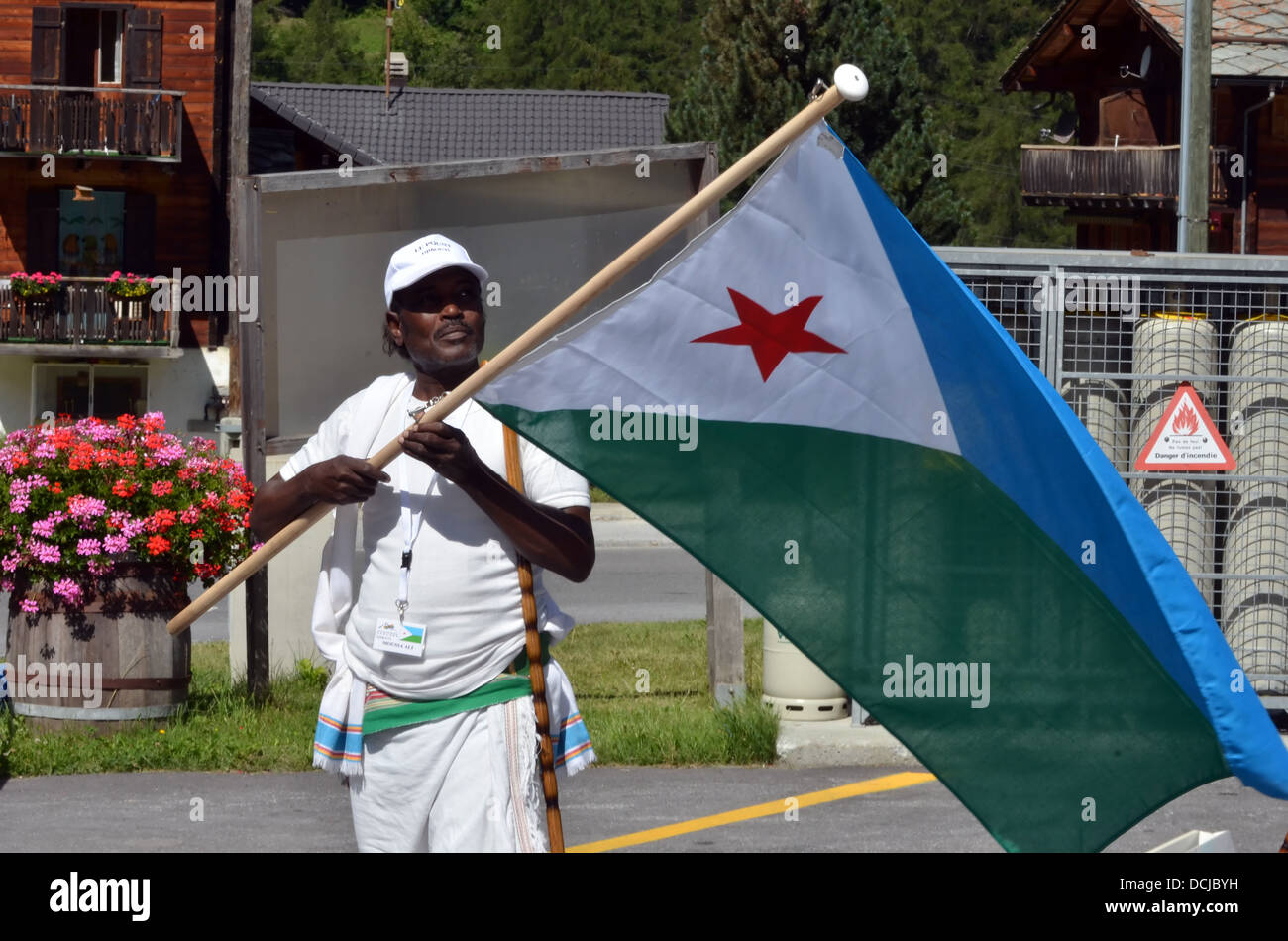 Djibouti flag bearer at the International Festival of Folklore and Dance from the - Stock Image