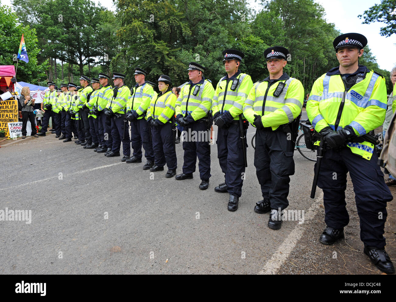 A line of police ready to stop anti fracking protesters who have set up camp next to the Cuadrilla site at Balcombe - Stock Image