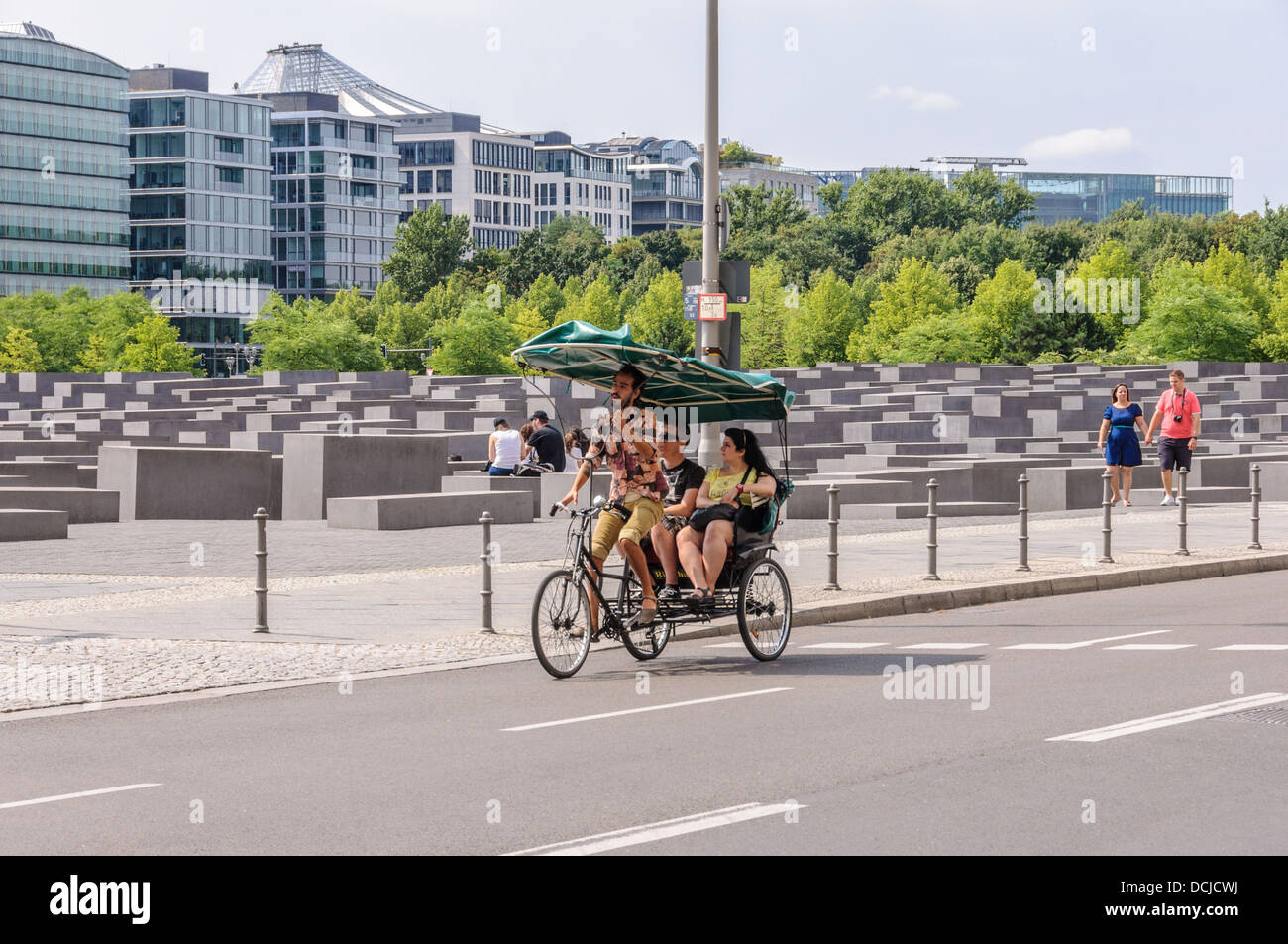 Rickshaw, pedicap with tourists at the Holocaust Memorial - Memorial to the Murdered Jews of Europe - Denkmal für Stock Photo