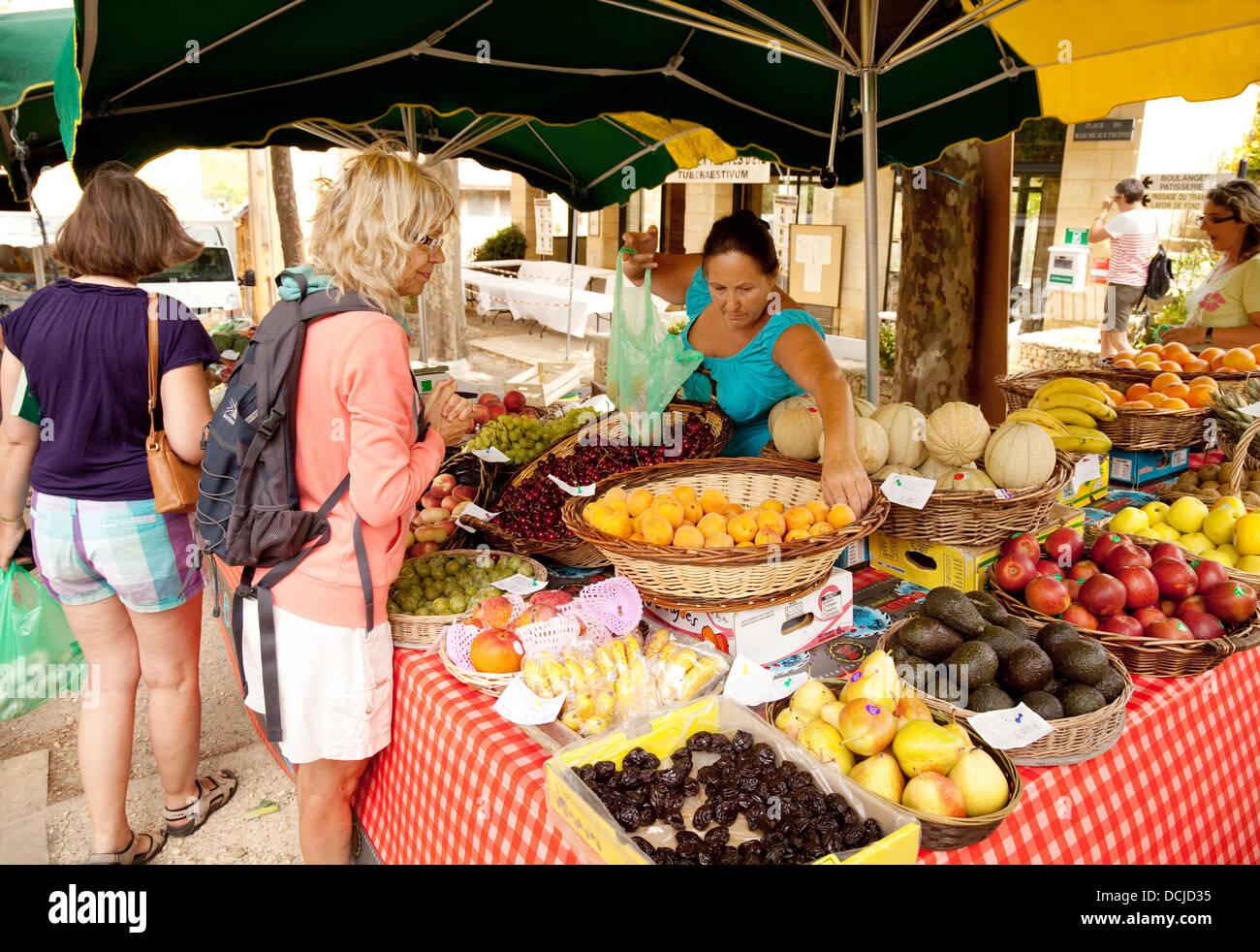 People shopping for fruit in the village market, Ste Alvere, the Dordogne, France Europe - Stock Image