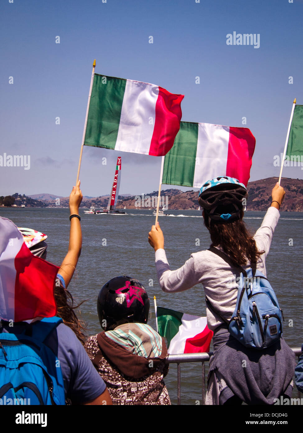 Luna Rosa Challenge is cheered on by fans in San Francisco Bay competing against the Emirates Team New Zealand in - Stock Image