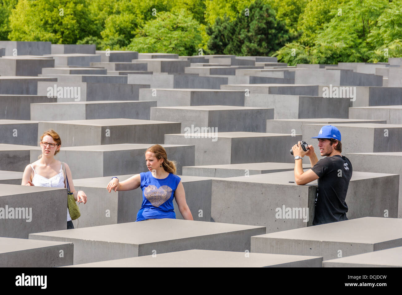 3 young people at the Holocaust Memorial - Memorial to the Murdered Jews of Europe - Denkmal für die ermordeten Stock Photo